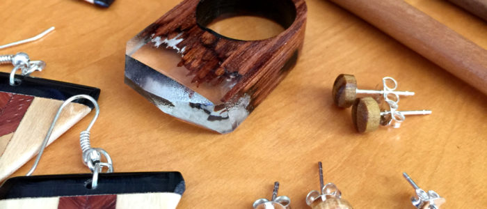 Wood would be good - a modern take on wooden jewellery